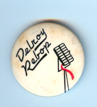 The rarer shorter red cable Delroy Rebop button.